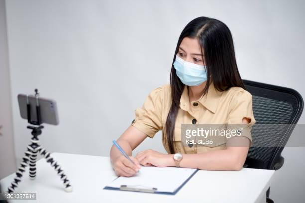 asian girl sitting at company she