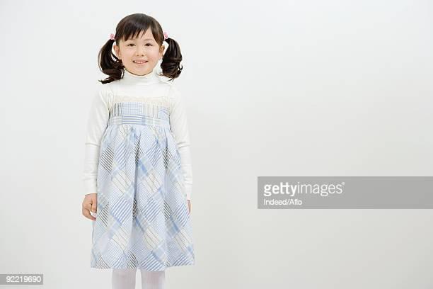 Asian girl smiling and looking at camera