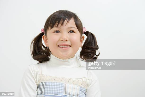 Asian girl smiling and looking up