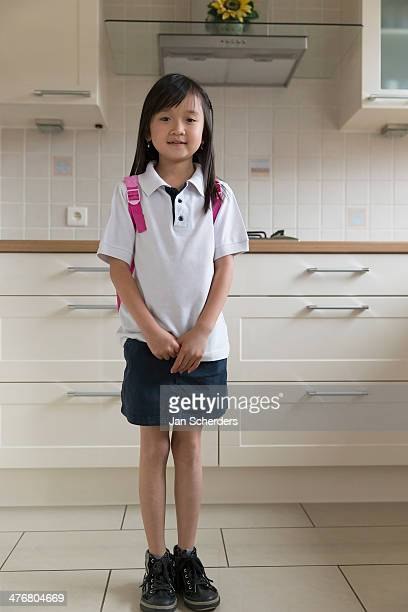 Asian girl smiling in kitchen