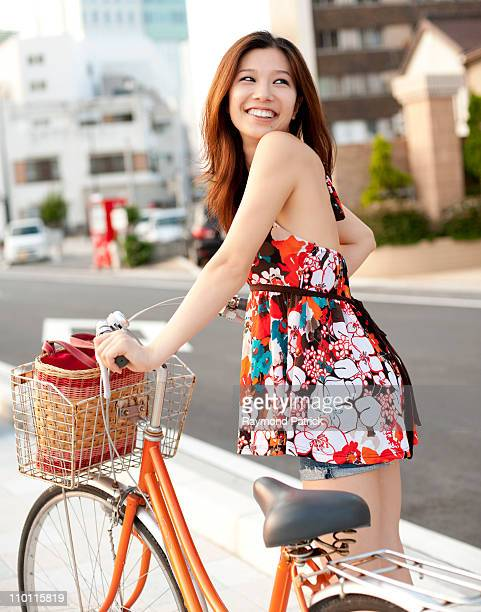 Asian girl smiling with bike