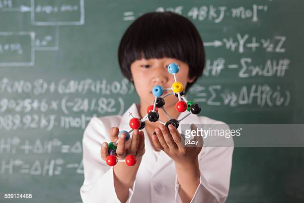 asian girl standing in front of chalk board