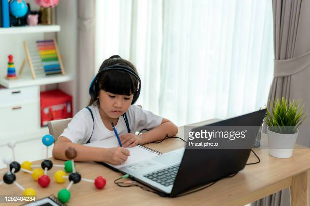 asian girl student video conference e-learning science class with teacher and classmates on computer in living room at home. homeschooling and distance learning ,online ,education and internet. - homeschool stock pictures, royalty-free photos & images