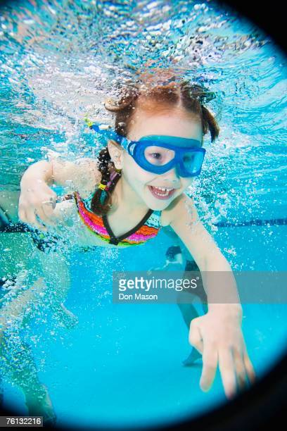 Asian girl swimming under water