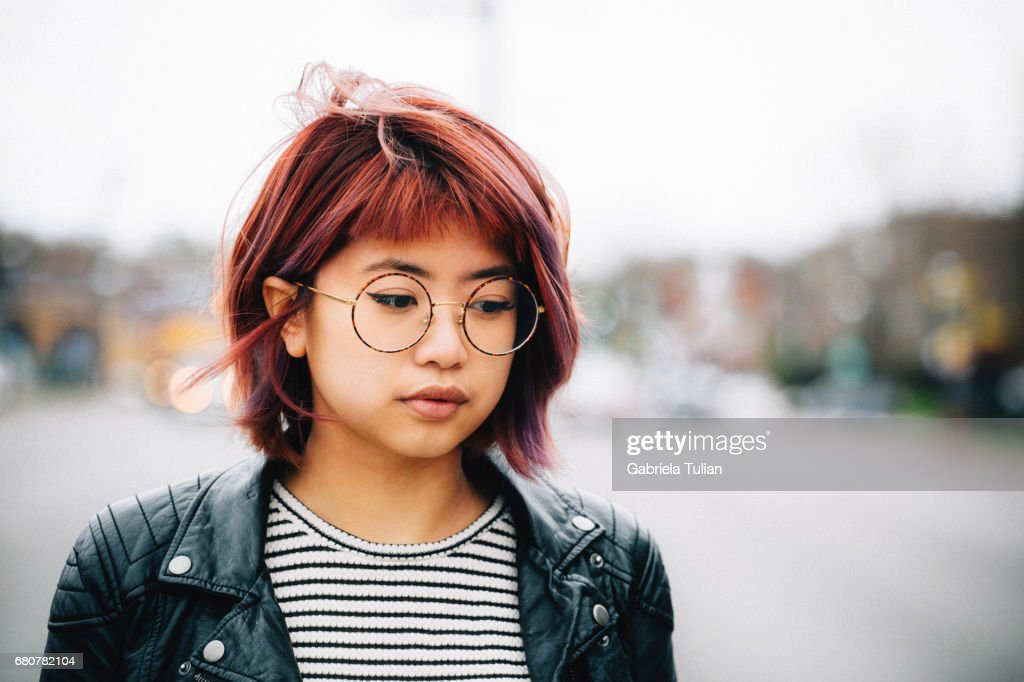 Asian girl walking in the city : Stock Photo