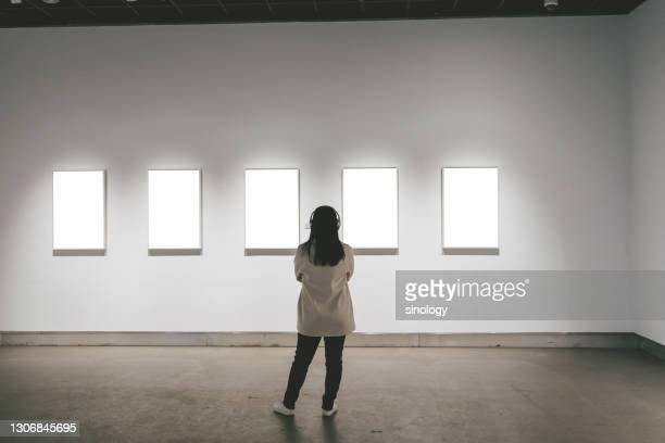 asian girl watching painting in art gallery - art gallery stock pictures, royalty-free photos & images