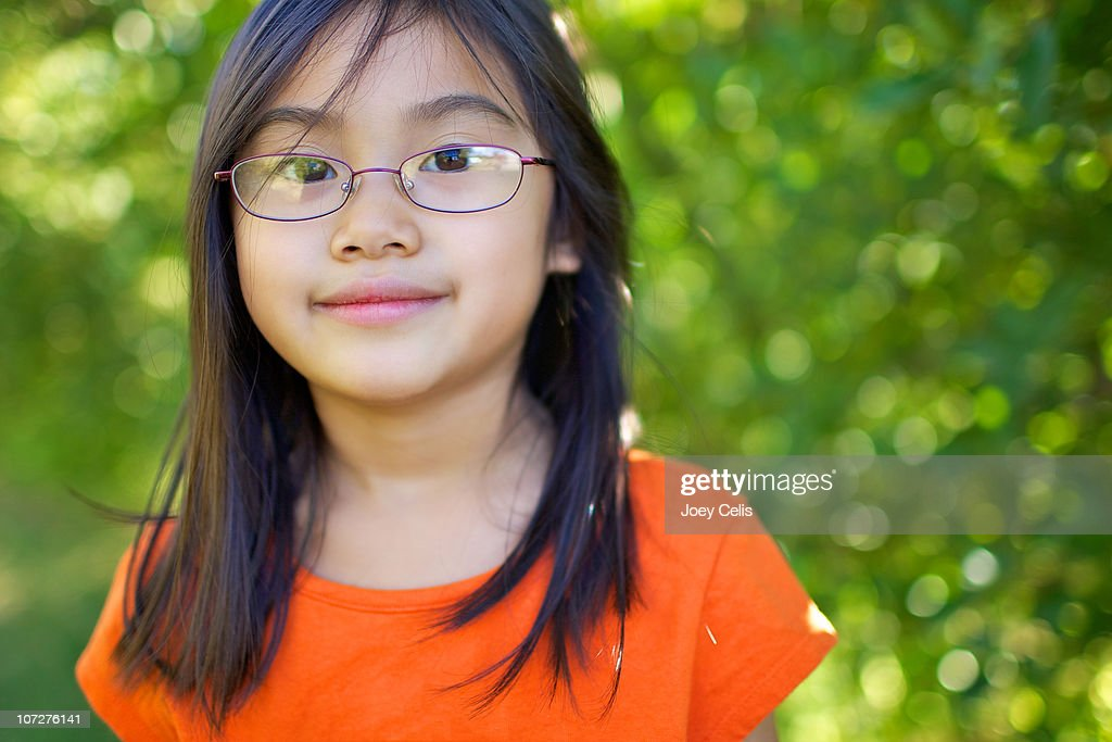 Asian Girl With Glasses Smiles In An Orchard Stock Photo  Getty Images-2210