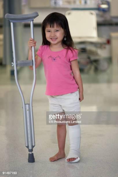 asian girl with leg in cast - gipsbein stock-fotos und bilder