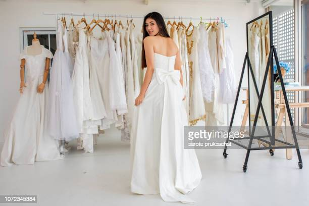 asian girls try out wedding dresses . - the past stockfoto's en -beelden