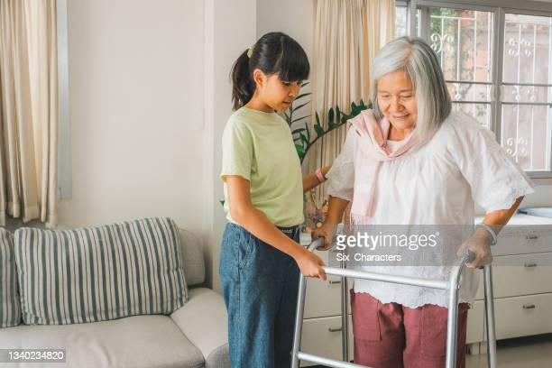 asian granddaughter helping her grandmother patients