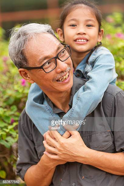 Asian Grandfather and Grandchild Playing