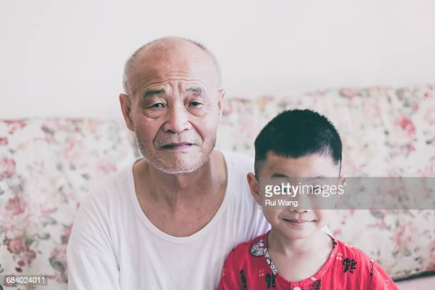 Asian grandfather and grandson in sleepcoats