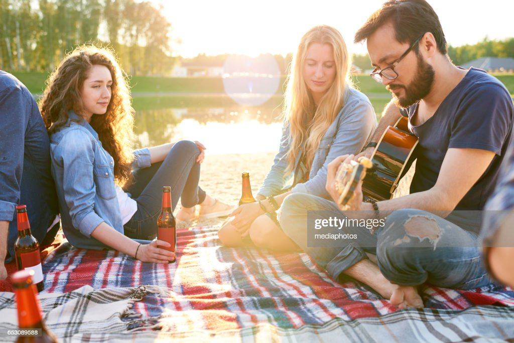 Asian guitarist and his friends : Stock Photo