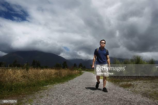 Asian Guy Walking Along Lake Matheson
