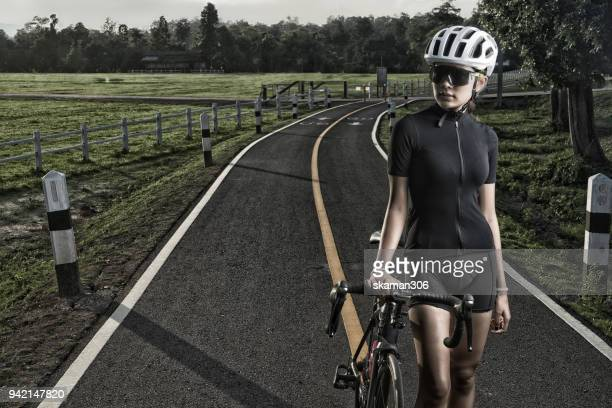 asian healthy cyclist girl wearing helmet cycling and exercise on bicycle in sprint track and open road - cycling event stock pictures, royalty-free photos & images