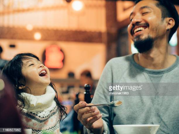 asian hipster father eating korean barbecue buffet with his daughter in the restaurant. - tradition stock pictures, royalty-free photos & images