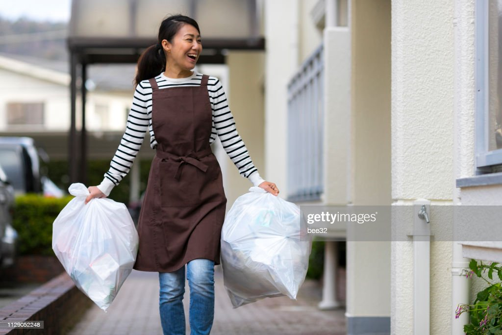 Asian housewife with garbage : Stock Photo