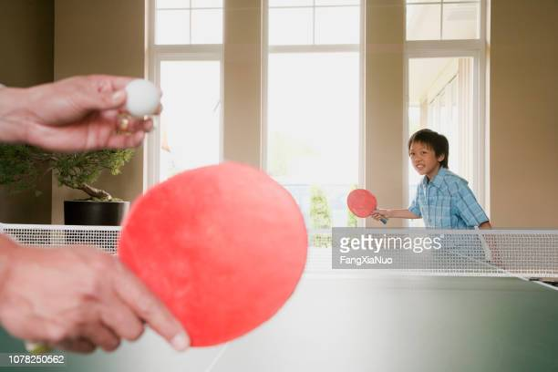 asian husband and son playing ping pong - richmond british columbia stock photos and pictures