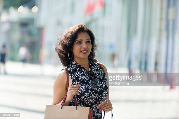 asian indian woman shopping at shopping district - sleeveless stock pictures, royalty-free photos & images