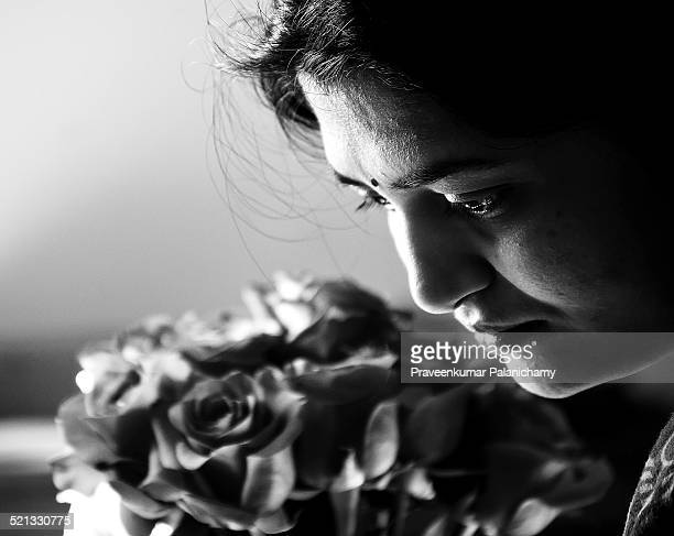 asian indian woman with flowers - black and white instant print stock pictures, royalty-free photos & images