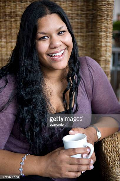 asian indian young woman portrait holding coffee cup in cafe - curvy asian woman stock pictures, royalty-free photos & images