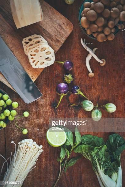 asian ingredients thai eggplant, chili, thai asparagus, lotus root, chili, bean sprout and tofu - enoki mushroom stock pictures, royalty-free photos & images