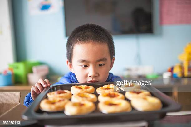 Asian kid watching food