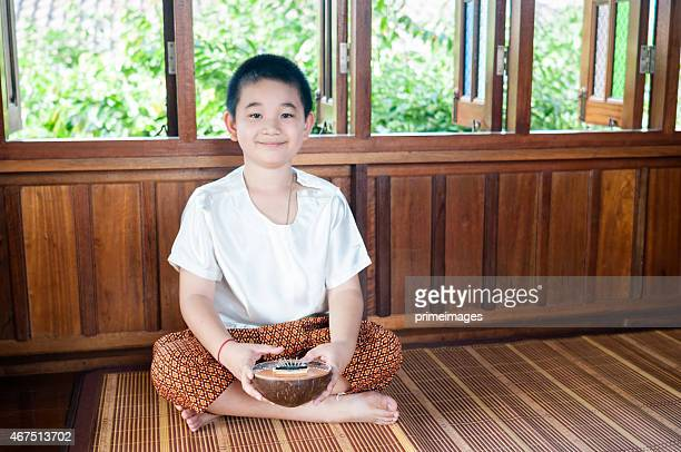 Asian kid with traditional costume on festival