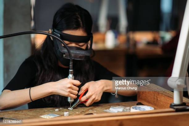asian korean female student making jewelry at college workbench - jewellery stock pictures, royalty-free photos & images