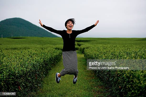 Asian Korean woman jumping excitedly