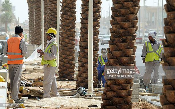 Asian labourers work on a highway construction site in eastern Riyadh on April 7 2013 Saudi Arabia has given illegal foreign workers a threemonth...