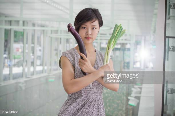 asian lady have a vegetables and play kung fu - 勝負 ストックフォトと画像