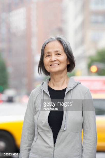 asian lady street portrait - korean ethnicity stock pictures, royalty-free photos & images