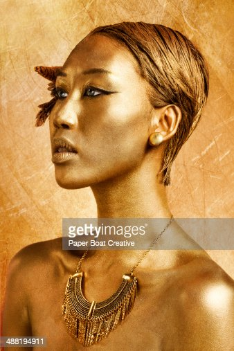 Asian Lady With Gold Body Paint On Face And Hair Stock ...