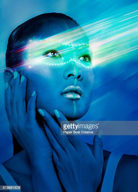 Asian lady with hologram head piece and laser beam