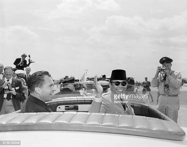 Asian leader responds to capital welcome Washington DC President Sukarno of Indonesia waves from his open limousine in response to greeting accorded...