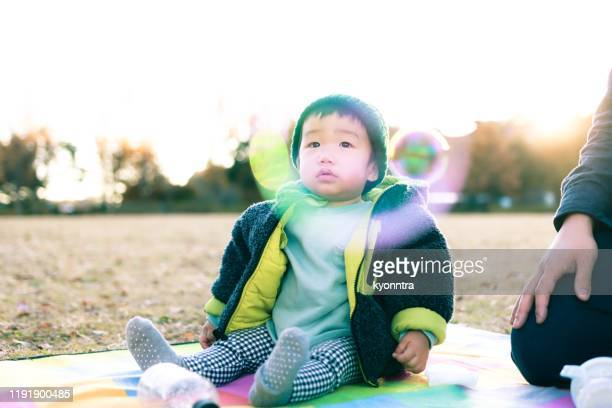asian little boy in winter - kyonntra stock pictures, royalty-free photos & images