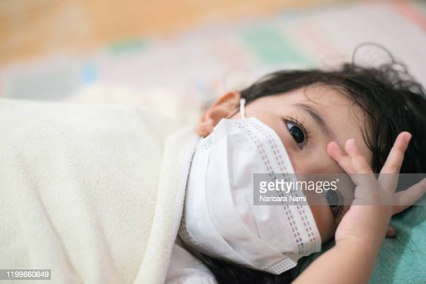 asian little child girl feeling headache. illness,sickness concept. - child hospital stock pictures, royalty-free photos & images