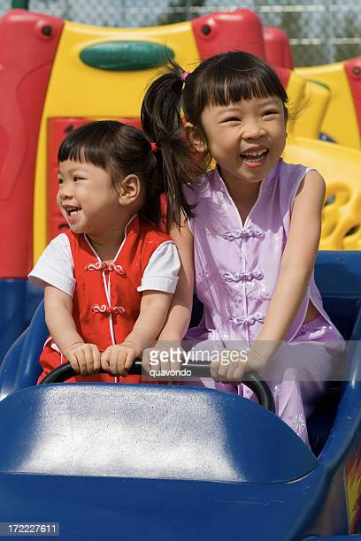 Asian Little Girls Playing on Outdoor Park Playground, Copy Space