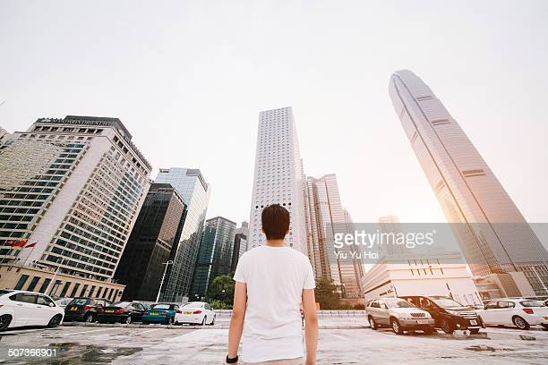 Asian male looking away city on fresh morning