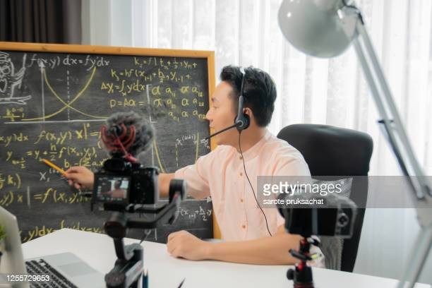 asian male teacher teaches physics through video conferencing, e-learning, and online distance learning. - teaching stock pictures, royalty-free photos & images