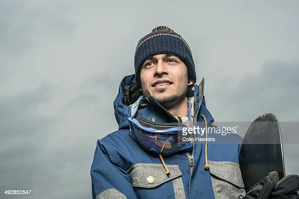 asian male with snowboard - colin hawkins stock pictures, royalty-free photos & images