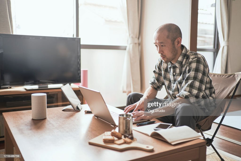 Asian male worker working from Home. : Stock Photo