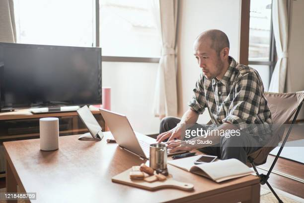 asian male worker working from home. - working from home stock pictures, royalty-free photos & images