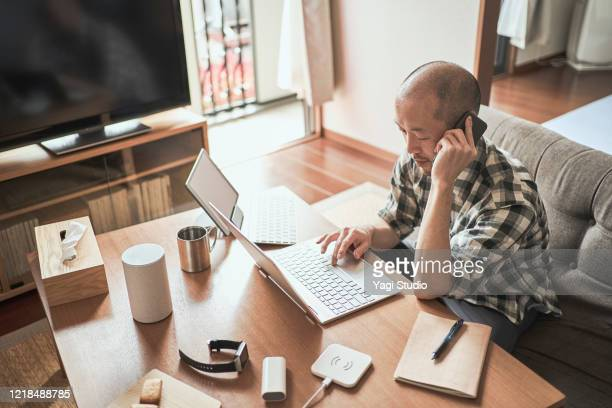 asian male worker working from home. - small business stock pictures, royalty-free photos & images