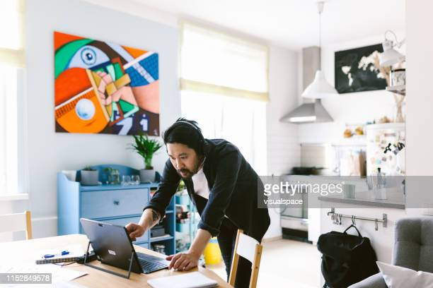 asian man arguing during conference call - east asian ethnicity stock pictures, royalty-free photos & images