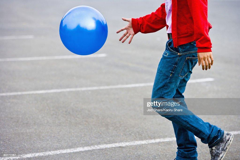 Asian man bouncing ball : Stock Photo