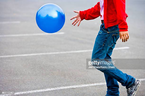 Asian man bouncing ball