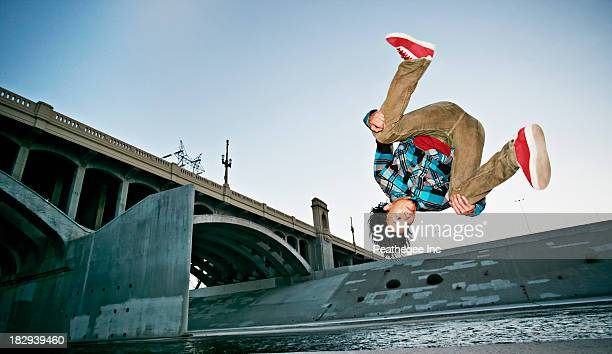 asian man break dancing under overpass - breakdancing stock photos and pictures