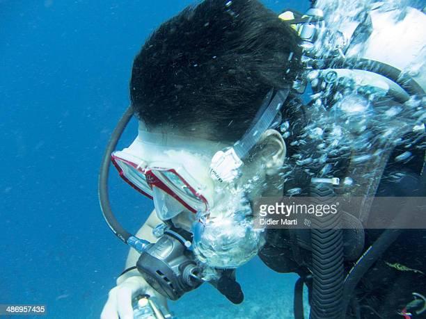Asian man diver underwater in Phuket Thailand